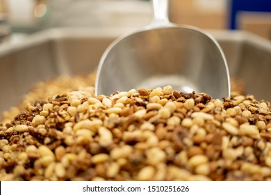 factory worker processing nuts packaging in a clean enviroment