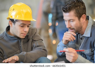 factory workers discussing planning