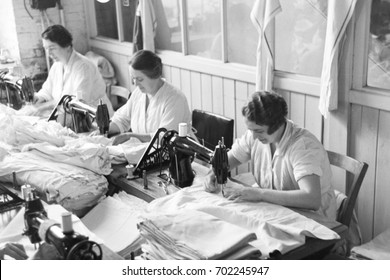Factory workers sewing pillow cases