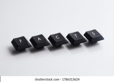 Facts word on black cube with white background