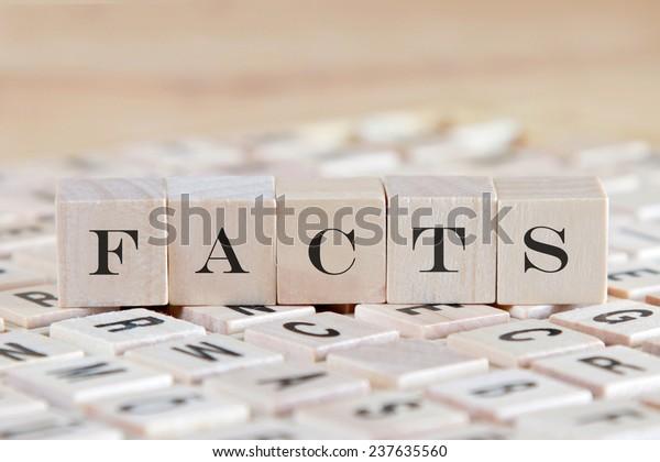 facts word on wood blocks