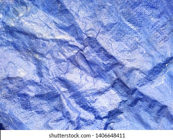 Faded blue plastic construction tarp abstract horizontal background texture
