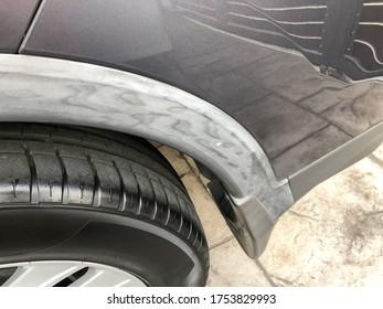 Faded car trim and bumper
