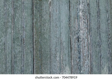 Faded and chipped blue green barn wood