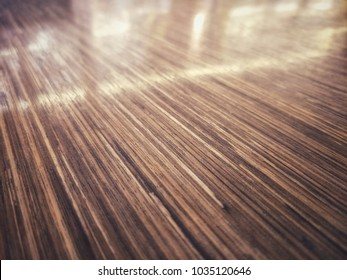 Faded glow texture image of oblique space from empty wooden table surface with light reflection for display of product or for montage.