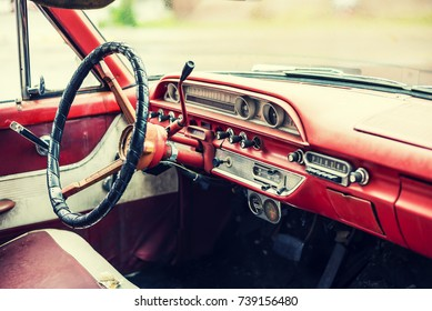 Faded interior of a classic american car from the 1960's.