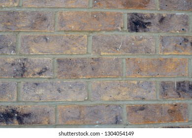 faded old beige brown brick wall texture background.