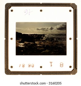 An faded old slide of a seascape (which is my own photo, therefore no copyright problem) that could be replaced with an image of the designer's choice.
