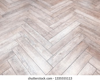 Faded and vintage tone of wooden panels zig zag pattern on the floor in light grey