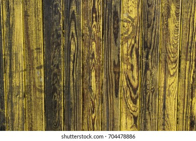 Faded yellow barn wood with a vertical grain