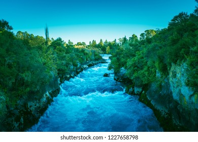 Fading day over churning waters of Waikato river above Huka Falls. Taupo, New Zealand