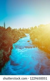 Fading day over rapid waters of Waikato river above Huka Falls. Taupo, New Zealand