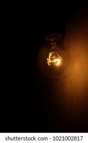 fading lamp next to the wall, little light warm shades