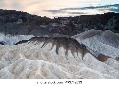 Fading light sunset contrasting light Over Zabriskie Point, Death Valley, California, USA