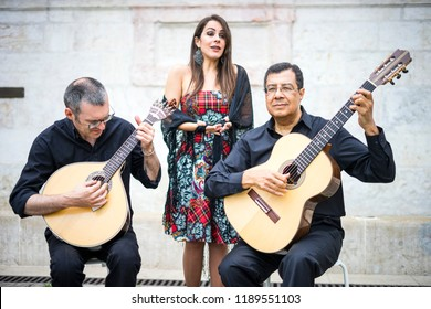 Fado band performing traditional portuguese music on the square of Alfama, Lisbon, Portugal