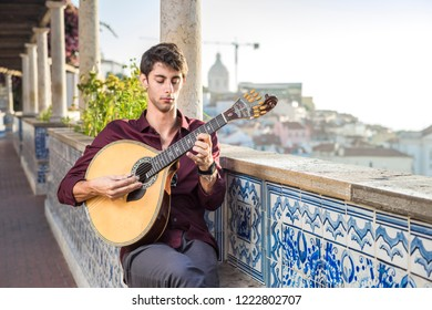Fado musician playing on portuguese guitar in Lisbon, Portugal