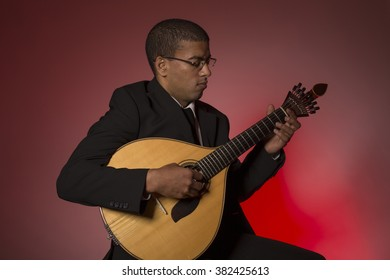 fado musician with a portuguese guitar, studio