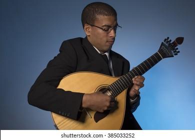 fado musician with a portuguese guitar, studio