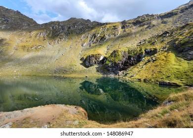 Fagaras Mountains in Romania - scenic view of Lake Balea.