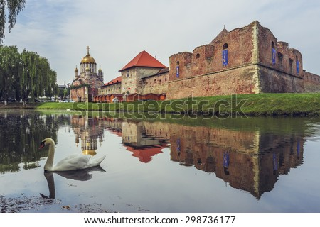 FAGARAS, ROMANIA - JUNE 4, 2015: Fagaras fortress, built around 1310, surrounded by a wide defensive ditch filled with water, one of the largest and best preserved feudal castles in Eastern Europe.
