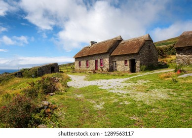 Fahan, Ireland - August 3, 2018 : Slea Head Famine Cottages built in the mid nineteenth century housing people through one of the worst famines in Western Europe, The Great Irish Famine.