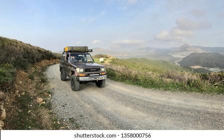 Fahs Anjra, Morocco - 02 24 2017: Toyota Land Cruiser LJ70 on a gravel track whilst travelling overland through Morocco