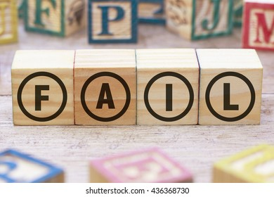 Fail word written on wood cube