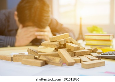 Failure Business,Problem Solving,businessman can't stop effect of dominoes continuous toppled with hand at desk,retro style image executive and risk control concept,selective focus,vintage color
