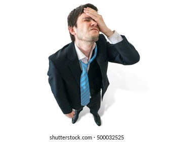 Failure and disappointment concept. Disappointed and unhappy businessman from top. Isolated on white background.