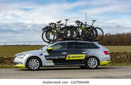 Fains-la-Folie, France - March 5, 2018: The technical car of Mitchelton Scott Team driving on a country road after the passing of the peloton during the stage 2 of Paris-Nice 2018.