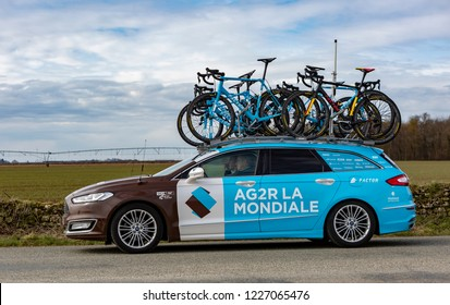 Fains-la-Folie, France - March 5, 2018: The technical car of AG2R La Mondiale Team driving on a country road after the passing of the peloton during the stage 2 of Paris-Nice 2018.