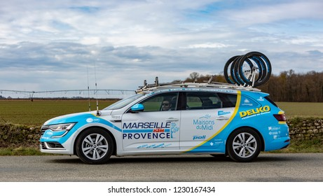 Fains-la-Folie, France - March 5, 2018: The technical car of Delko Marseille Provence KTM Team driving on a country road after the passing of the peloton during the stage 2 of Paris-Nice 2018.