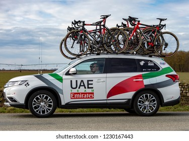 Fains-la-Folie, France - March 5, 2018: The technical car of  UAE-Team Emirates driving on a country road after the passing of the peloton during the stage 2 of Paris-Nice 2018.