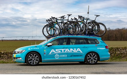Fains-la-Folie, France - March 5, 2018: The technical car of  Astana Team driving on a country road after the passing of the peloton during the stage 2 of Paris-Nice 2018.