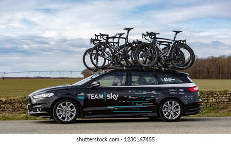 Fains-la-Folie, France - March 5, 2018: The technical car of  Team Sky driving on a country road after the passing of the peloton during the stage 2 of Paris-Nice 2018.