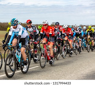 Fains-la-Folie, France - March 5, 2018: The Dutch cyclist Koen de Kort of  Trek-Segafredo Team riding in the peloton on a country road during the stage 2 of Paris-Nice 2018.