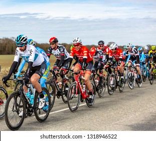 Fains-la-Folie, France - March 5, 2018: The Spanish cyclist David Lopez of Team Sky riding in the peloton on a country road during the stage 2 of Paris-Nice 2018.