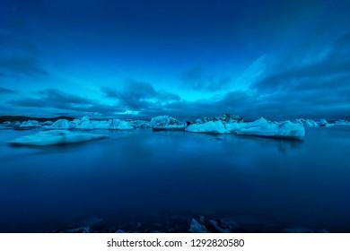Faint aurora borealis at Jokusarlon Glacial Lagoon, Southeast Iceland.