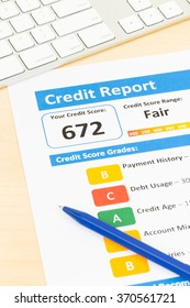 Fair credit score report with pen and keyboard