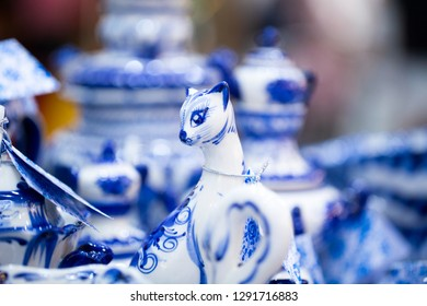 Fair with dishes and souvenirs in Russian traditional style. Traditional colors are blue and white. Gzhel - Russian folk craft from ceramics and porcelain production. Close-up.