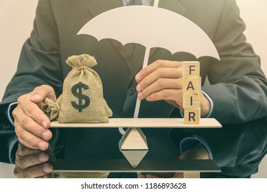 Fair value pricing / debt or money at fair value concept : Dollar money bags on a basic balance scale, businessman as an insurer protects or guards his properties, depicts protecting high risk assets