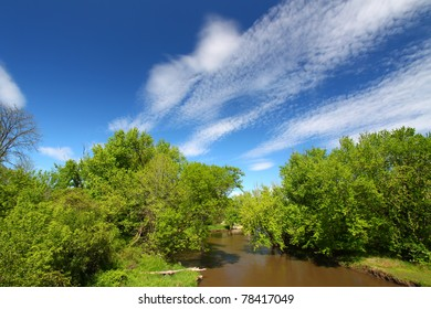 Fair weather clouds on a spring day over the Kishwaukee River of Illinois