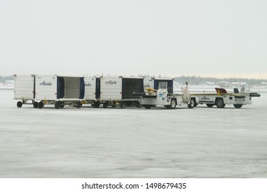 Fairbanks Airport, Alaska - March 7 2019 : Airport baggage trailer during a winter