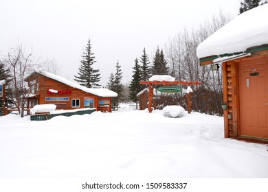Fairbanks, Alaska, March-7-2019 : Log cabins covered with fresh snow in Pike's Waterfront Lodge
