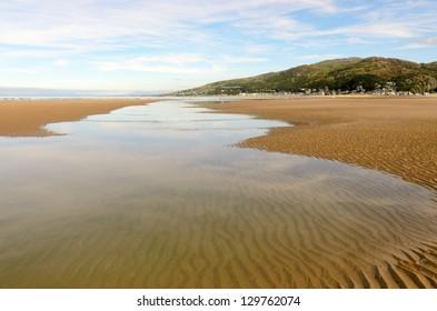 Fairbourne Beach looking north towards Barmouth in Gwynedd Wales.