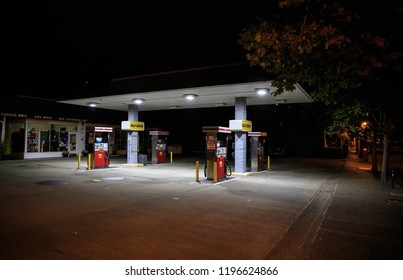Fairfax, California - August 22, 2018: Empty pumps at gas station on dark night in center of small town