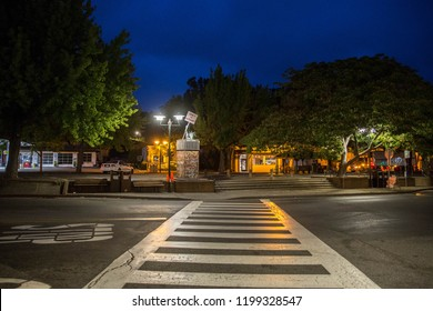 Fairfax, California - August 22, 2018: Crosswalk leads to public protest sign in the center of small town in predawn hours
