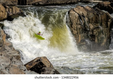Fairfax County, Virginia / USA - 8/19/2017: Unidentified kayakers race down the Great Falls waterfalls of the Potomac river, during the Great Falls Race event.