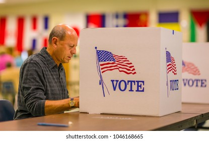 FAIRFAX COUNTY, VIRGINIA, USA - NOVEMBER 4, 2008: Voter at polls during presidential election, using paper ballots.
