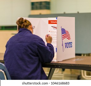 FAIRFAX COUNTY, VIRGINIA, USA - NOVEMBER 4, 2008: Woman voter at polls during presidential election.
